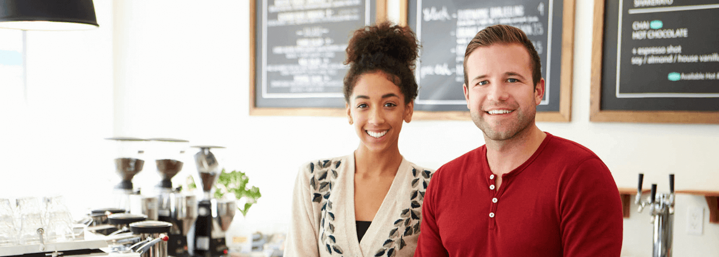 Image of a man and woman working in a coffee shop